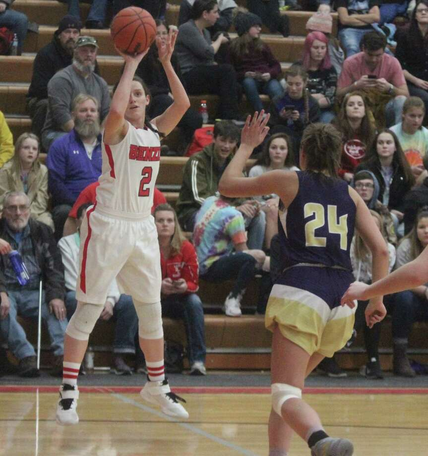 Abby Bretzke shoots a three from the corner, as she leads her team to victory over Frankfort. (File photo)