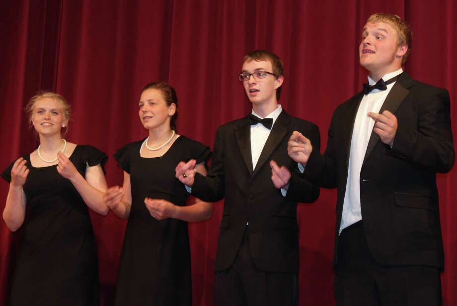 A REVUE TRADITION: Members of the Benzie Central choir sing in the 14th annual Rotary Revue, carrying on a tradition of involvement dating back to the very first revue.