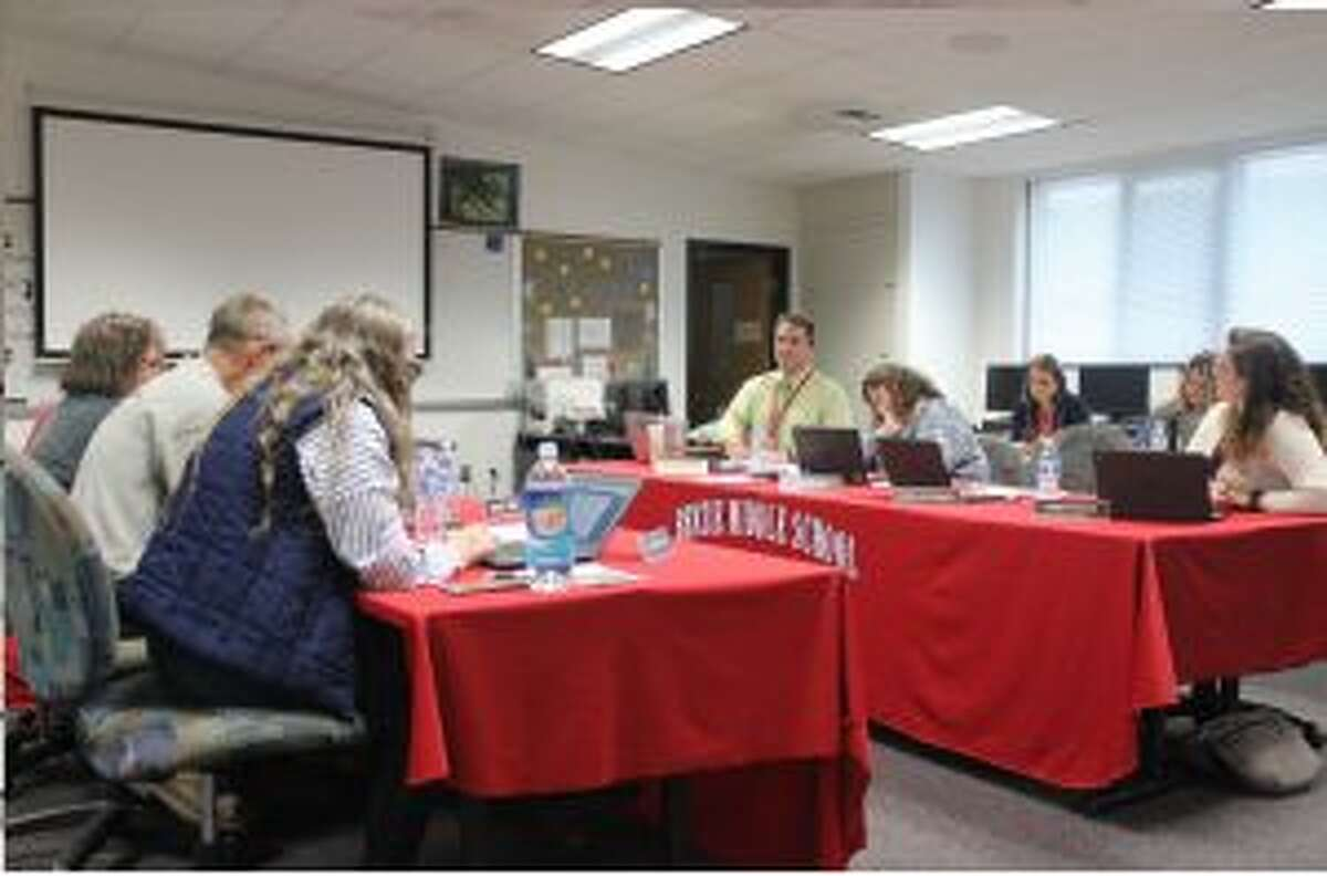 Members of Benzie Central's school board discuss TBAISD's upcoming election for board members. (Photo/Robert Myers)