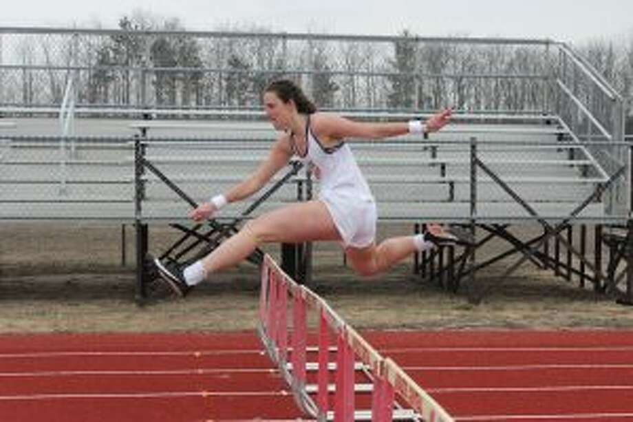 Abby Bretzke races the 300-meter hurdles during a intrasquad meet on April 6. (Photo/Robert Myers)