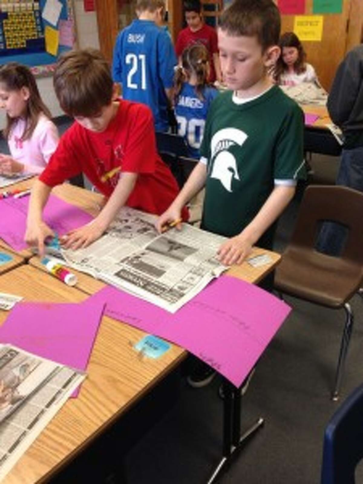 CUTTING OUT STORIES: Classrooms have figured out many different ways to use the Record Patriot in the Newspapers in Education program. Searching for specific stories or ideas in the paper is a major use to help in important English lessons.