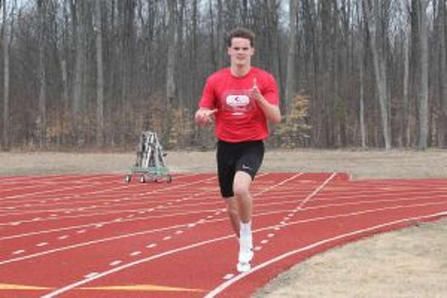 Benzie Central's Noah Barnes wins the 1600-meter run at an intrasquad meet earlier this spring. (Photo/Robert Myers)