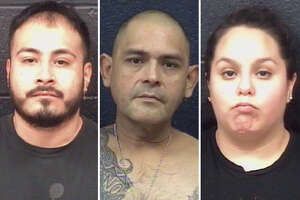 Laredo police arrested three people and seized street-level narcotics and a firearm following a couple of raids, authorities said Thursday.