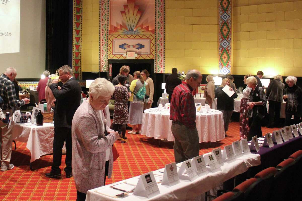 A crowing crowd surveys the silent auction items at Spring Fling. (Photo/Robert Myers)