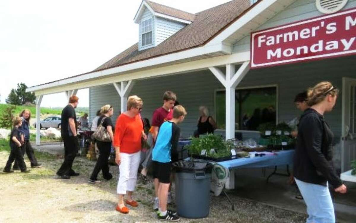 NEW FRIENDS: The Farmers Market at Grow Benzie takes place later in the day each Monday, to give everyone a chance to visit.
