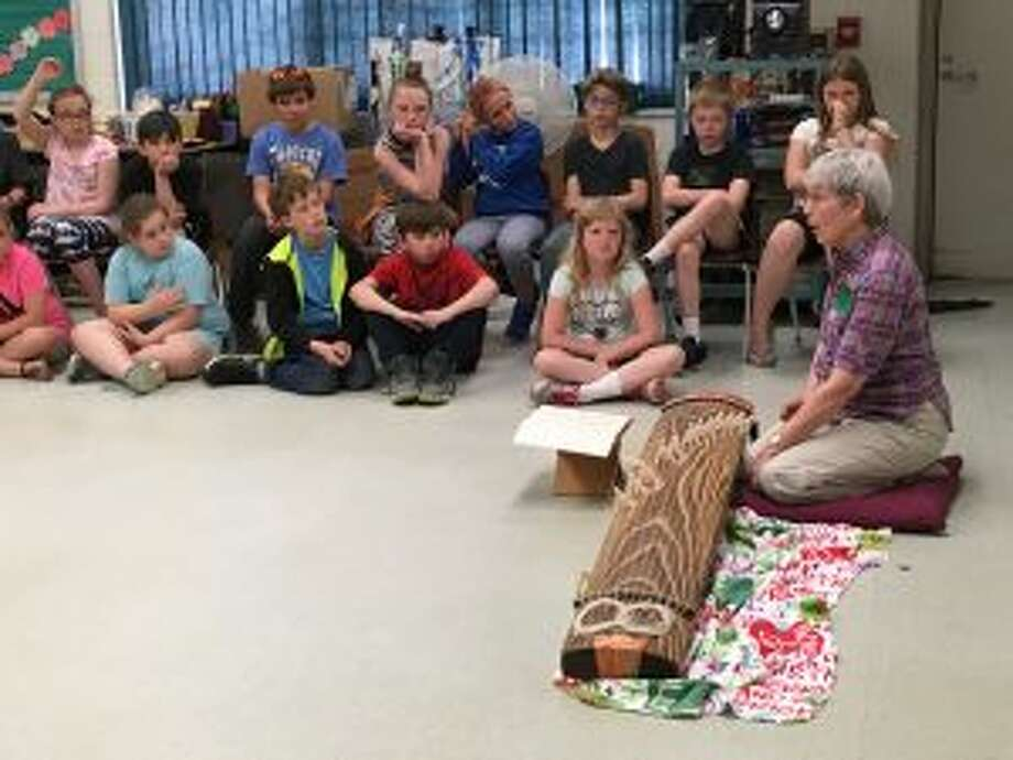 Local musician Ginny Freeman demonstrates her Japanese Koto to students in Nancy Reed's music class at Lake Ann Elementary.