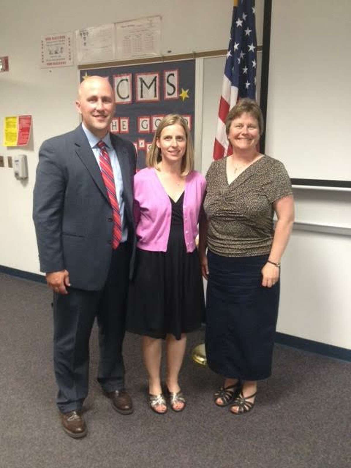 BIG WELCOME: New Benzie Central football coach and teacher Jason Katt (left) and new teacher Kylee Katt were welcomed to the community by Benzie Central Board of Education President Lorraine Nordbeck. (Courtesy photo)