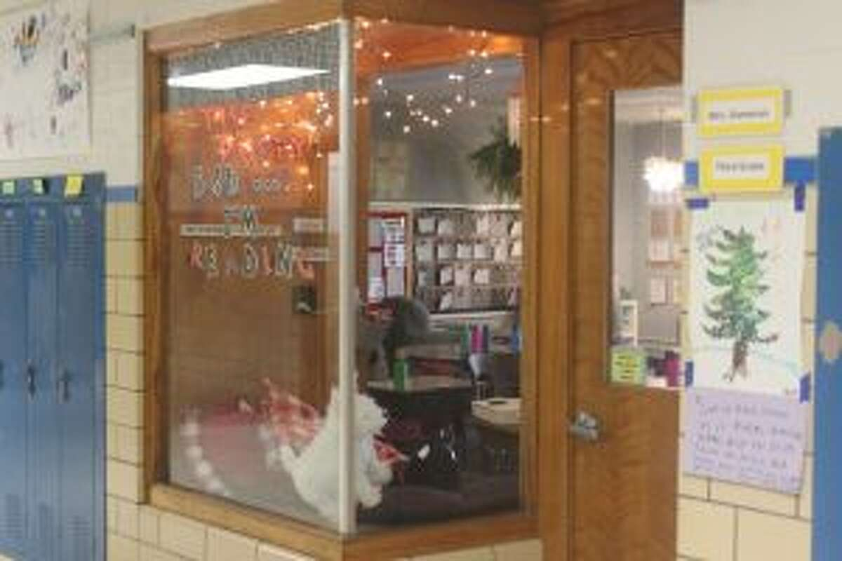 Crystal Lake teachers work to make their window cases look nice from the hallway, but there is no denying that they are a safety concern. (Photo/Robert Myers)