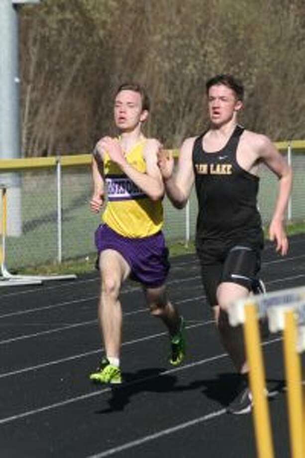 Owen Roth pushes past Glen Lake's Tommy Reay near the finish line to win the 1,600-meter run. (Photo/Dylan Savela)