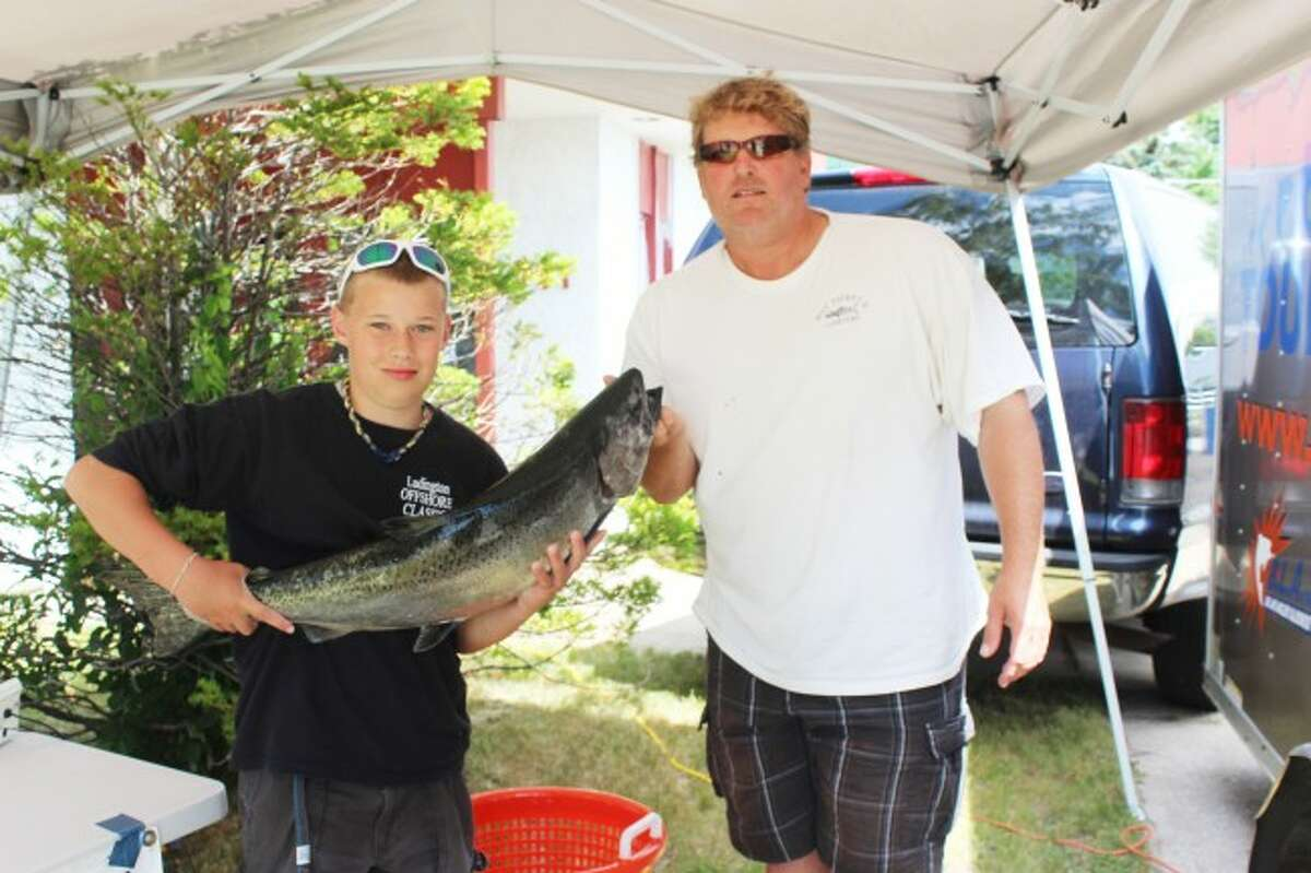 Young fishermen Wyatt Walter and Jeff show their catch from the Battle of the Betsie Bay last year. Men and women, young and old, took part in the first ever fishing contest, with many coming back to shore with very impressive catches.