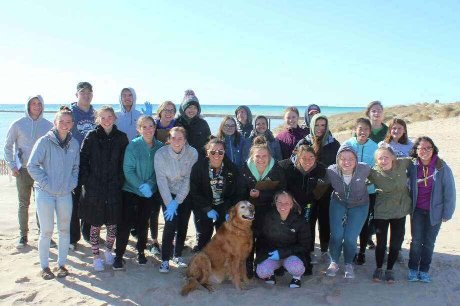 Frankfort High School National Honor Society members gather to cleanup Frankfort Beach. (Photo/Robert Myers)