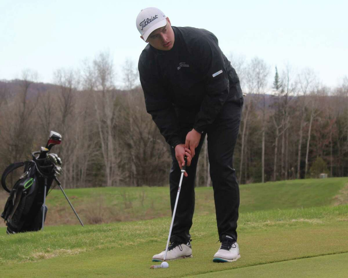 Jack Reznich lines up a putt during a scramble at Crystal Lake Golf Club on Friday. (Photo/Robert Myers)