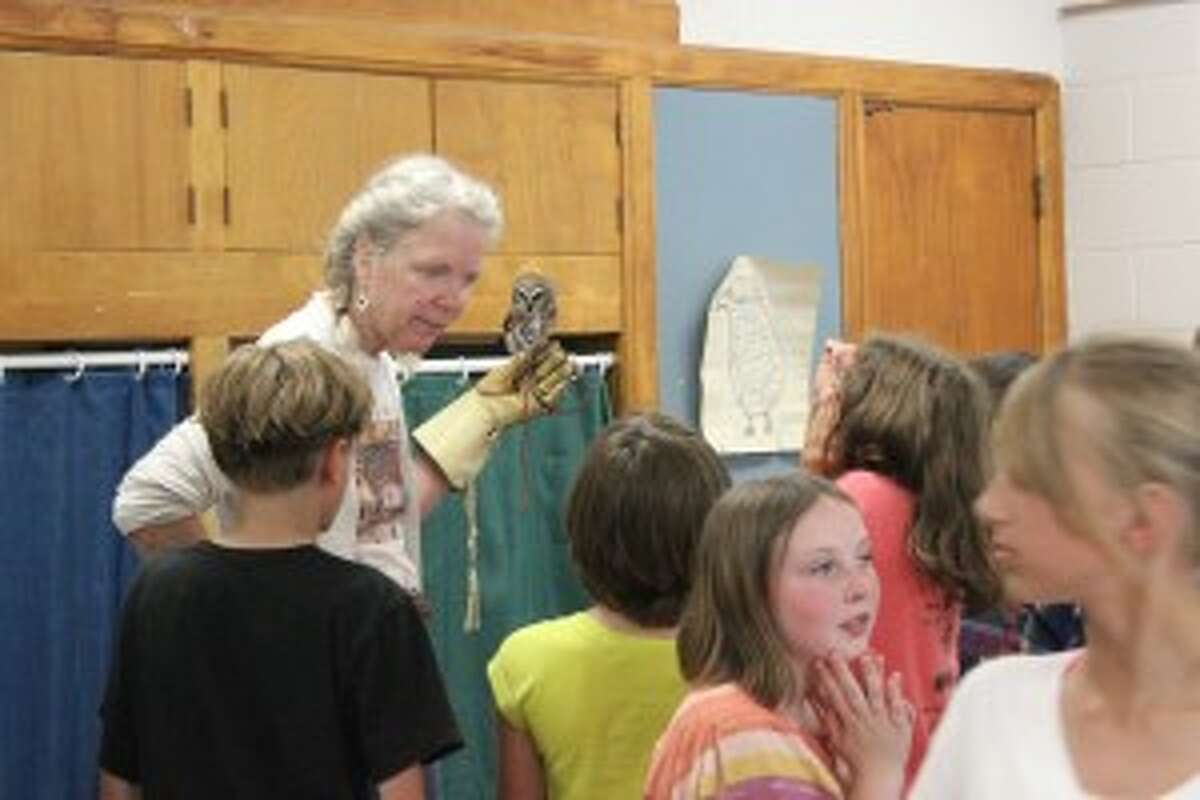 BIRDS OF BENZIE: Students from Benzie County were able to get close to several local birds when the Wings of Wonder group came to school. (Photo/Bryan Warrick)