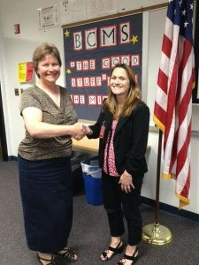 WELCOME ABOARD: Benzie Central School Board President Lorraine Nordbeck shakes hands with Amiee Erfourth, the newly appointed Betsie Valley Elementary School principal. (Courtesy photo)