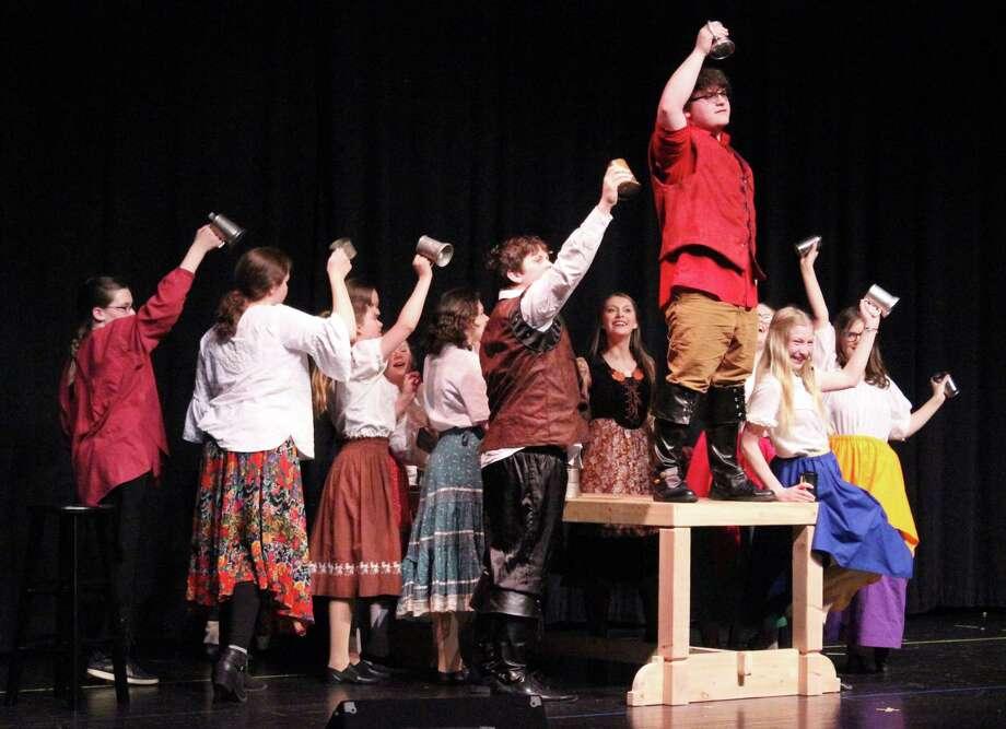 The village sings the praises of Gaston. (Photo/Robert Myers)