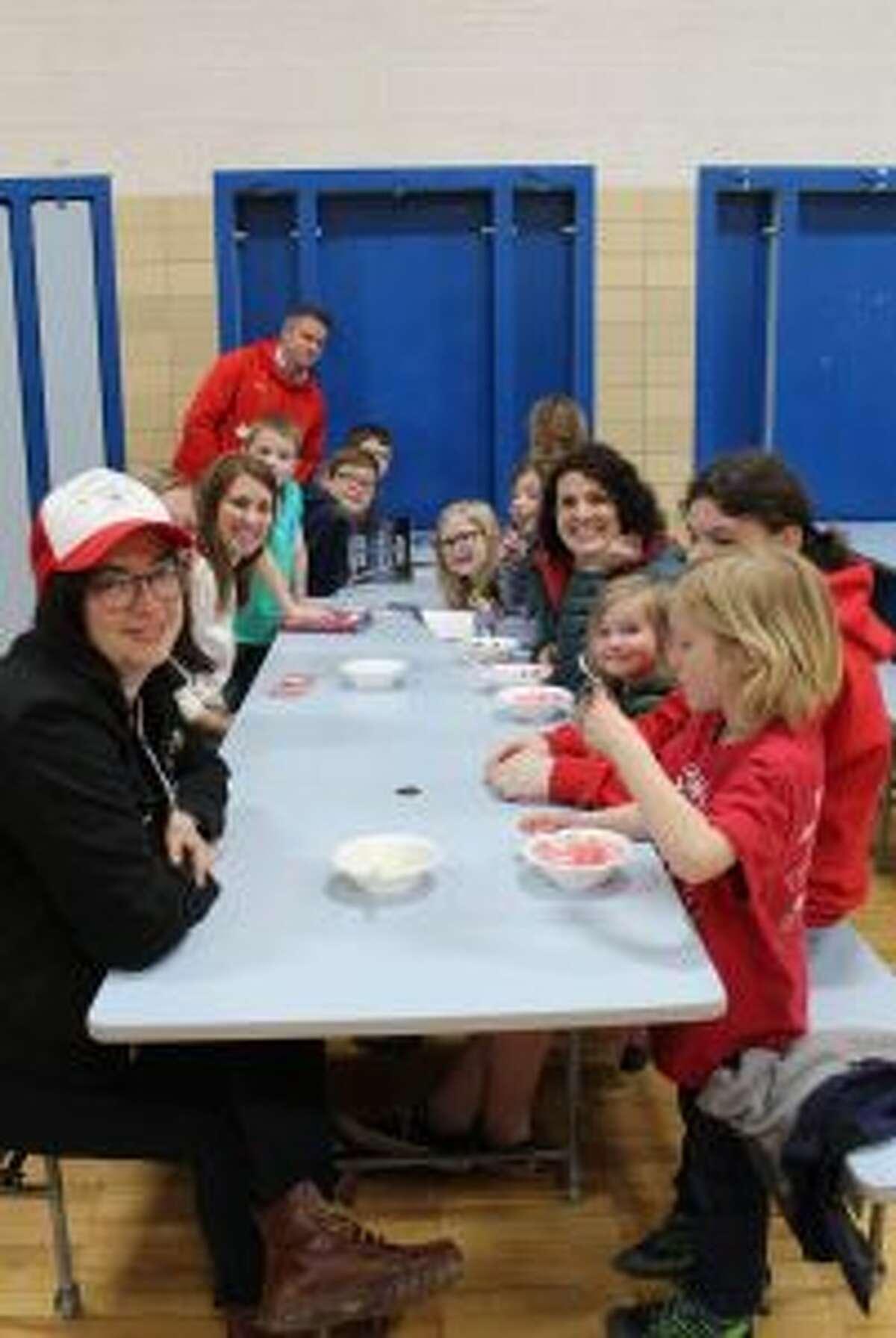 Families enjoy ice cream treats at the Crystal Lake Elementary Art Fair. (Courtesy photo)