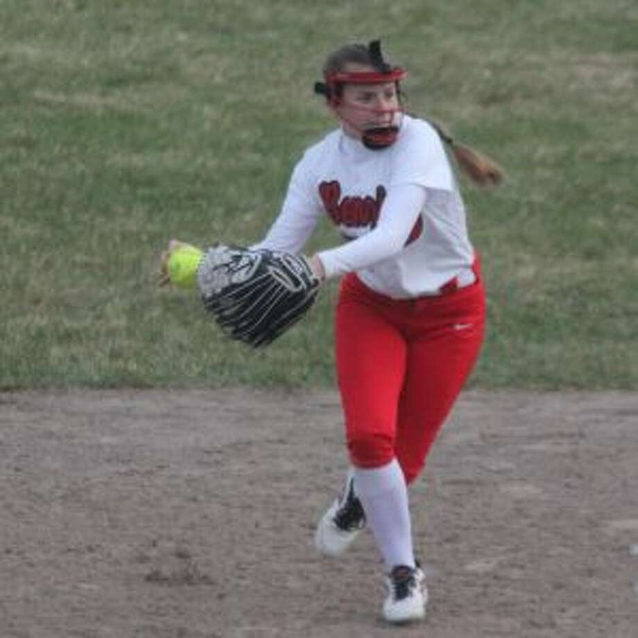 Kylee Streeter sets her feet to throw to first for the out. (Photo/Robert Myers)