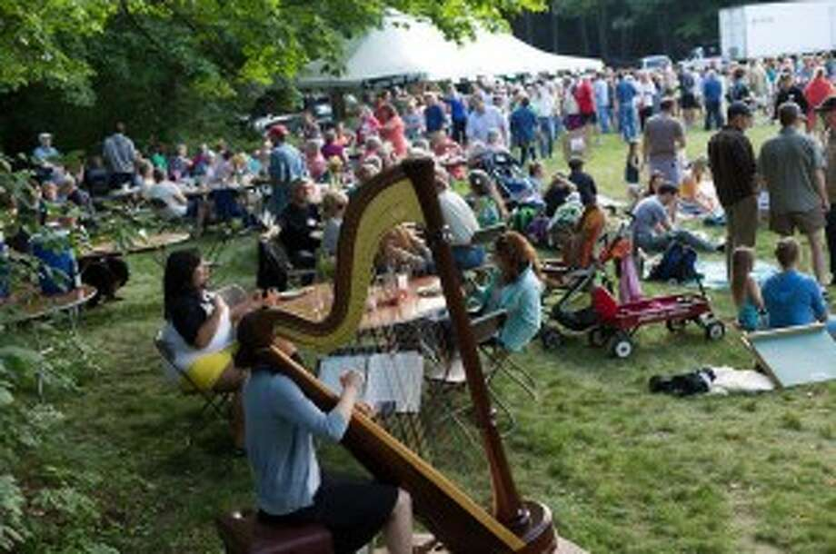 OUTDOORS FOR MUSIC AND FOOD: The Green Cuisine regularly brings in nearly 1,000 visitors every year, offering good food and drinks, along with helpful information about healthier and greener eating. (Courtesy Photo)