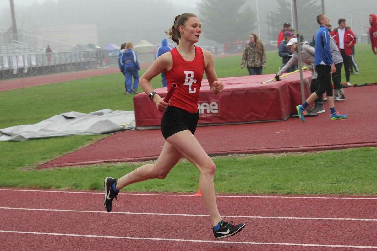 Ellen Bretzke helps the Huskies get off to a great start in the 4x800-meter relay. (Photo/Robert Myers)
