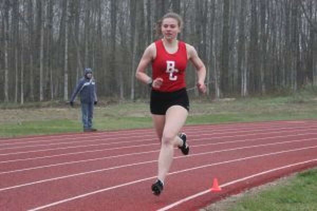 Paige Johnston crushes the competition in the 800-meter run. (Photo/Robert Myers)