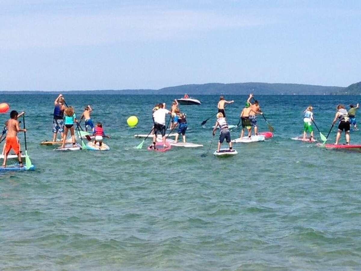 PADDLEBOARD KIDS: Kids take part in Stand Up Paddleboarding on Crystal Lake.