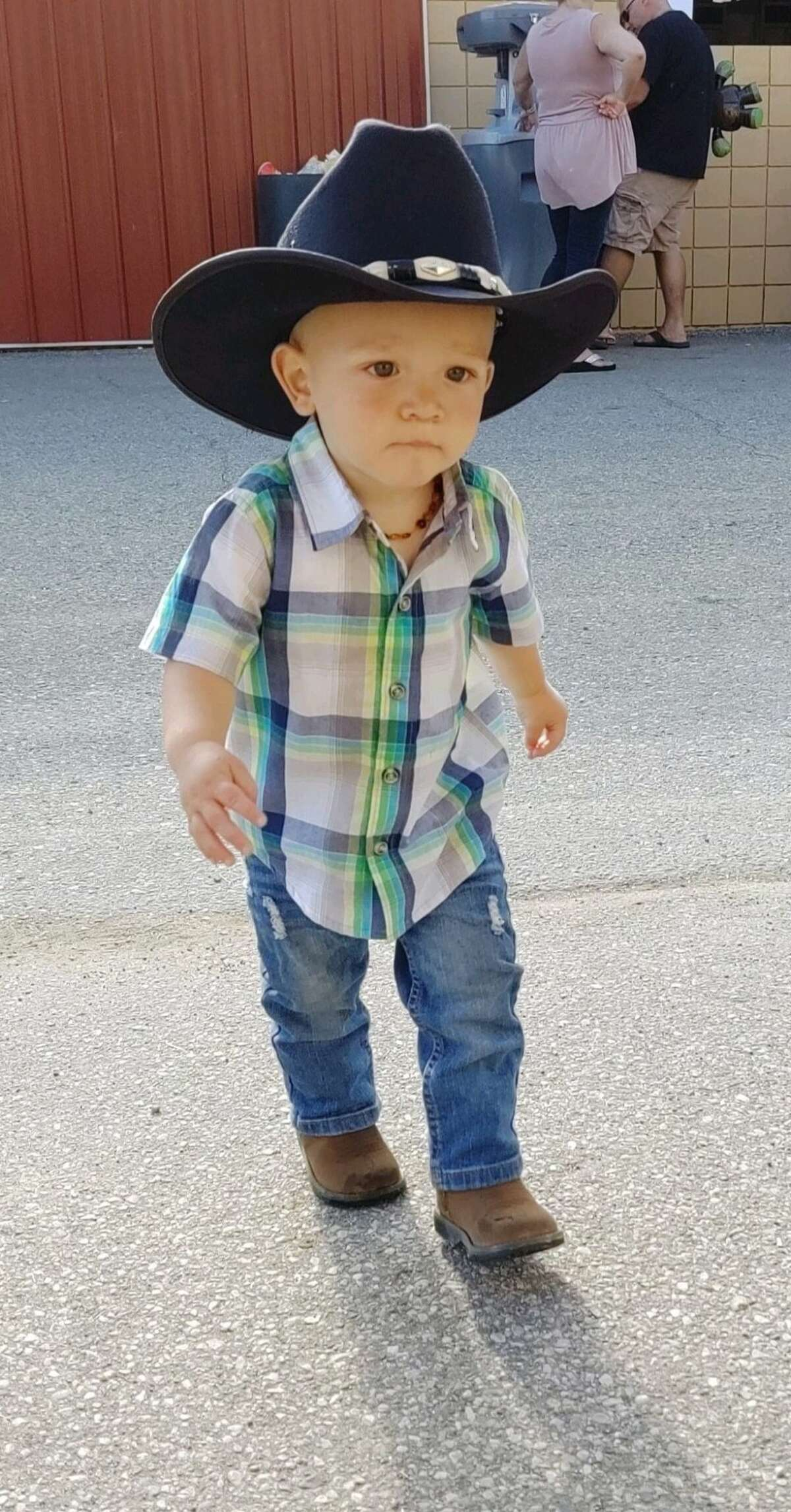 Axle Goodman, 18 months, walks around with his parents, Brittaney and Aaron Goodman (not pictured) at the Midland County Fair on Tuesday, Aug. 13, 2019. (Photo provided/Brittaney Goodman)