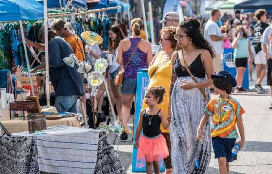 Crowds view items offered at the 2018 Mississippi Earthtones Festival in Alton. This year's event is planned Saturday, Sept. 21.