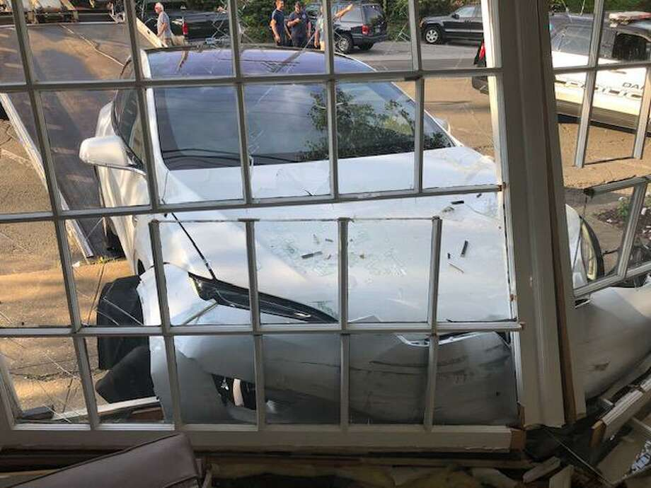 Photos of the Tesla that drove into a Tokeneke barber shop Thursday evening. Photo: Tom Velotti Photos