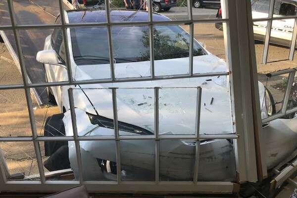 Photos of the Tesla that drove into a Tokeneke barber shop Thursday evening.