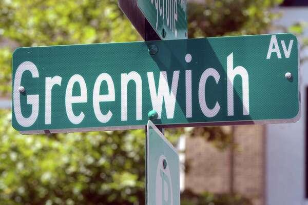 A sign marking Greenwich Avenue in Greenwich, Conn.