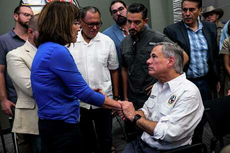 "Texas Representative Evelina ""Lina"" Ortega (L) shakes the hands of Texas Governor Greg Abbott after a press briefing, following a mass fatal shooting, at the El Paso Regional Communications Center in El Paso, Texas, on August 3, 2019. - A gunman armed with an assault rifle killed 20 people Saturday when he opened fire on shoppers at a packed Walmart store in the latest mass shooting in the United States. (Photo by Joel Angel JUAREZ / AFP)JOEL ANGEL JUAREZ/AFP/Getty Images"