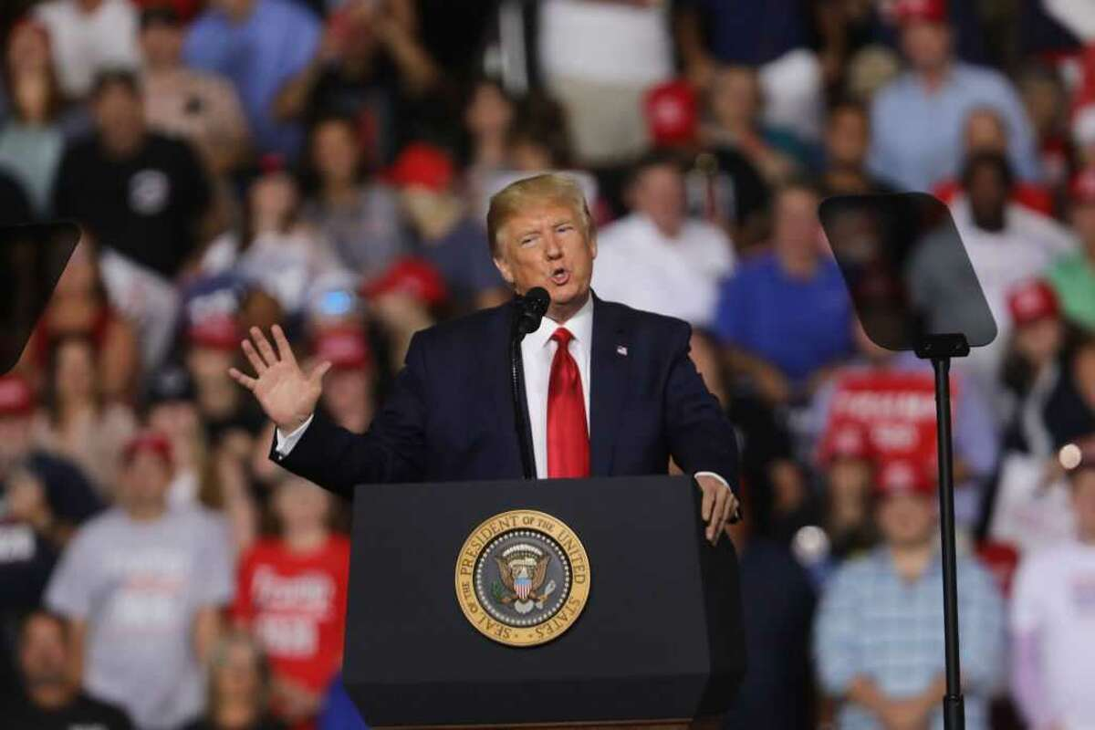 FILE - President Donald Trump fat-shamed a man who he thought was a protester being disruptive in the upper rungs of the stadium in Manchester, New Hampshire.