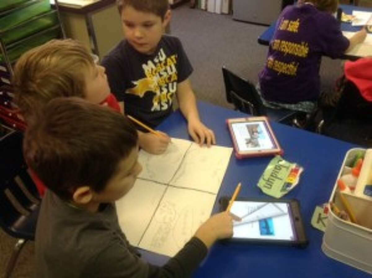 NEWEST TOOLS: Students at Frankfort use iPads to look up facts on marine life during class. The first graders have been using technology more as a tool to help learn in school. (Courtesy photo)