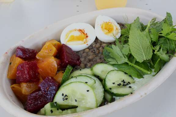 A beet and warm lentil salad with egg, yogurt, herbs and cucumber at Fava in Berkeley.