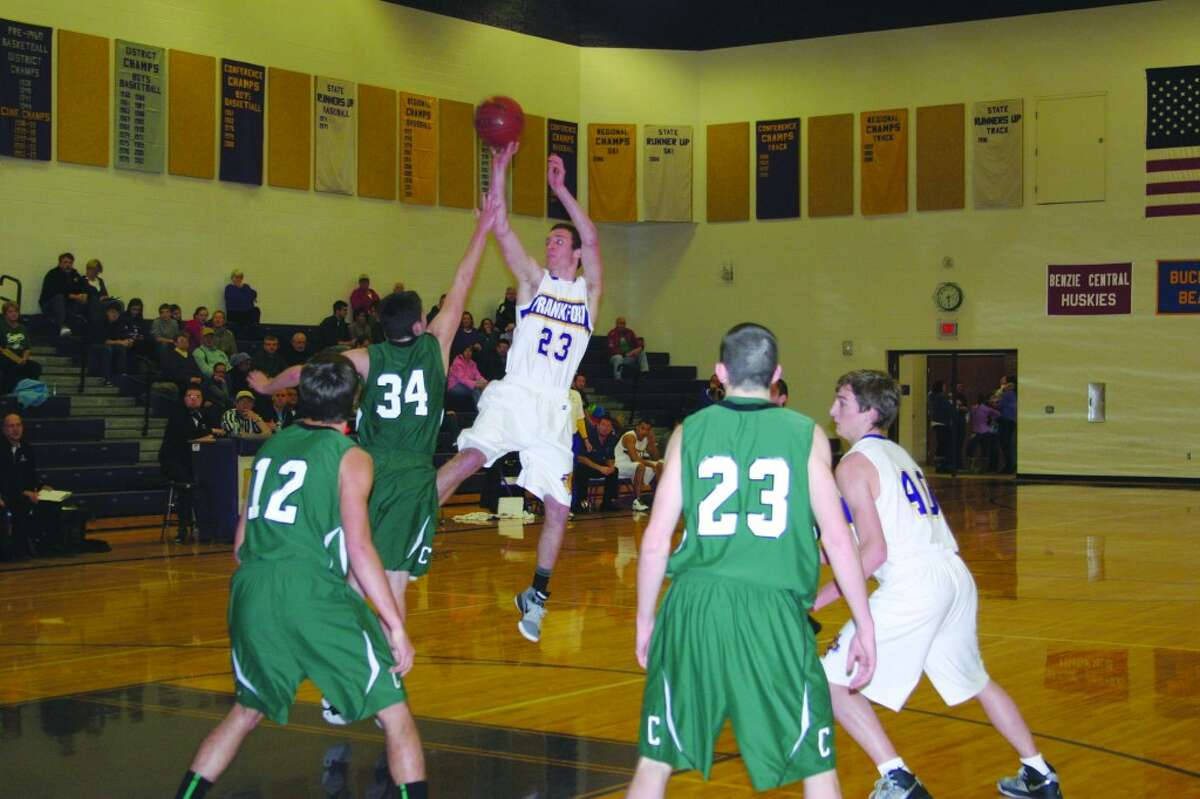 GOING BIG: Senior Owen Stratton takes a long shot. He had 19 points in the game. (Photos/Bryan Warrick)