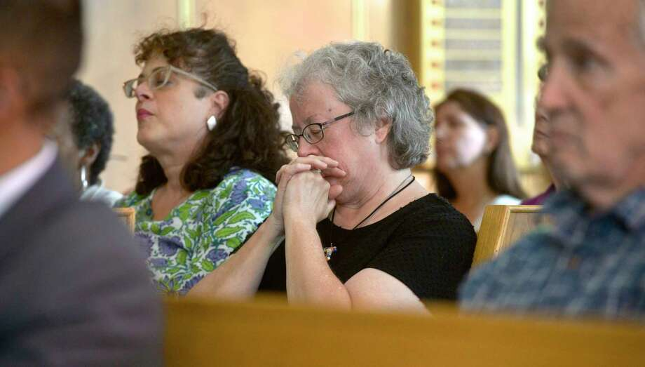 Debbie Isaacson, of Danbury, listens to the guest speaker at the Association of Religious Communities vigil, held in the wake of the back-to-back shootings in El Paso, Texas, and Dayton, Ohio. Thursday night, August 15, 2019,, at the United Jewish Center, in Danbury, Conn, Photo: H John Voorhees III / Hearst Connecticut Media / The News-Times