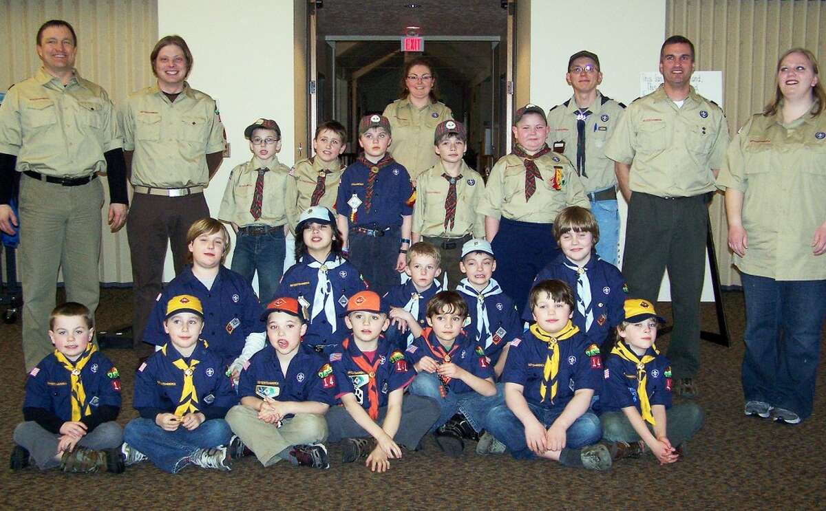 CUB SCOUT PACK 141: Members and adult leaders pose for their group photo.