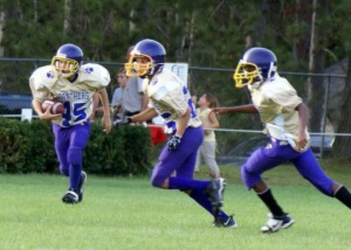 YOUNG PANTHERS: (LEFT TO RIGHT) Griffin Kelly, Ben Plumstead and Lonnie Hann push forward during the Jr High win.