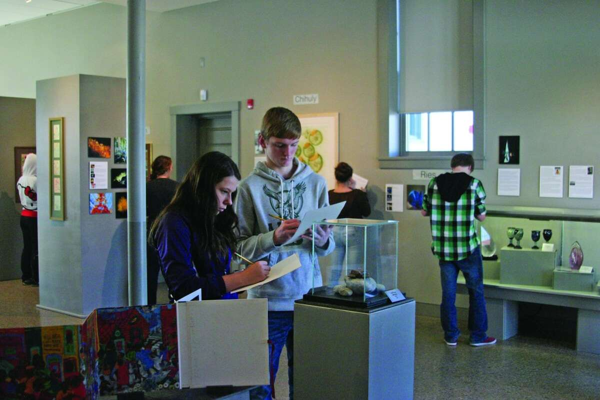 TAKING NOTES: Students explore the center, looking at the many different pieces of art and history on display. (Photos/Bryan Warrick)