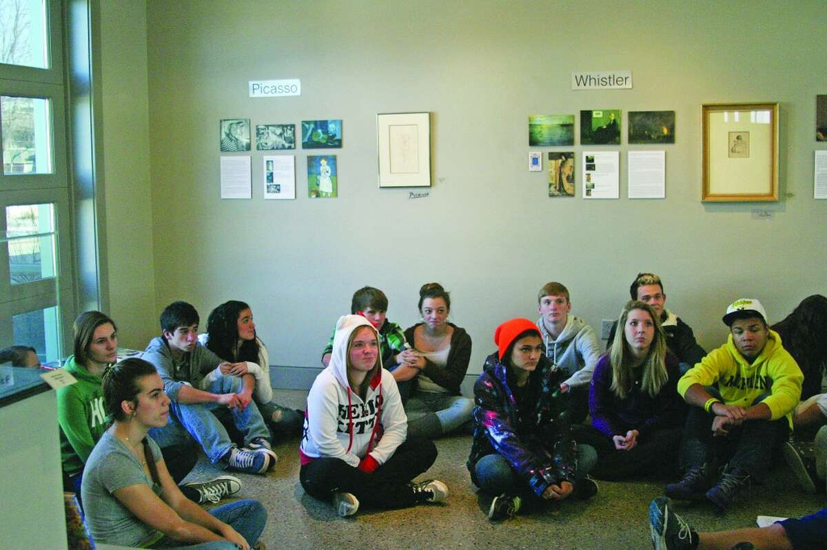 HISTORY: High School students listen to the stories behind the different artists and works of art.