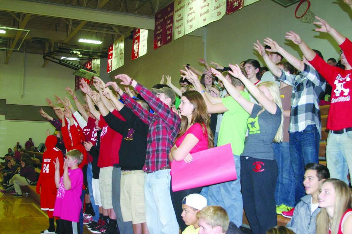CHEERING SECTION: The loud crowd cheered on the Huskies during their win over Manistee.