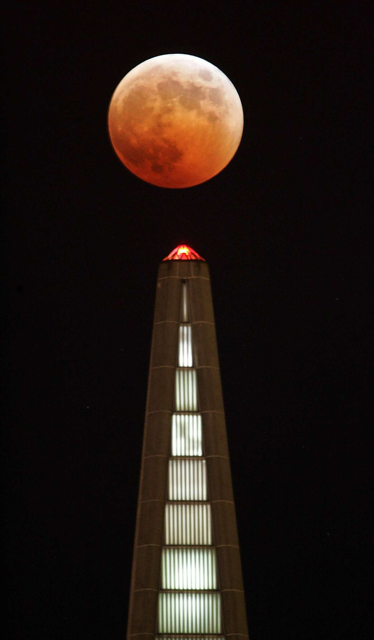 ECLIPSE_050_fl.jpg �A full eclipse of the moon, like an evil pumpkin, tops San Francisco Transamerica Pyramid Wednesday evening 10/27. The partial phase of the eclipse started 6:14 p.m., just as the full moon is rising from the east bay hills. Totality began at 7:23 p.m., when the moon, blood- red was tucked completely within Earth's shadow. The next total eclipse in the Bay Area can be viewed in the wee hours of the night August 28, 2007. 10/27/04 San Francisco CA Frederic Larson The San Francisco Chronicle Ran on: 10-28-2004 Photo caption Dummy text goes here. Dummy text goes here. Dummy text goes here. Dummy text goes here. Dummy text goes here. Dummy text goes here. Dummy text goes here. Dummy text goes here. Ran on: 10-28-2004 Photo caption Dummy text goes here. Dummy text goes here. Dummy text goes here. Dummy text goes here. Dummy text goes here. Dummy text goes here. Dummy text goes here. Dummy text goes here. Ran on: 10-13-2005