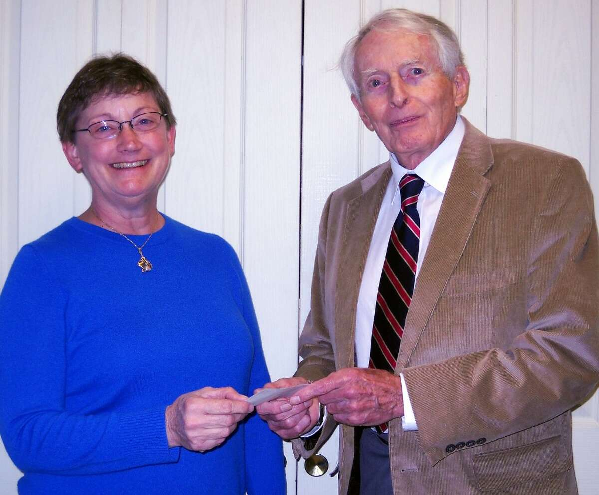 CSA COMMUNITY DONATIONS: Cliff Van Dyke of CSA presents a check to Mary Dykstra, executive director of Benzie Home Health Care.