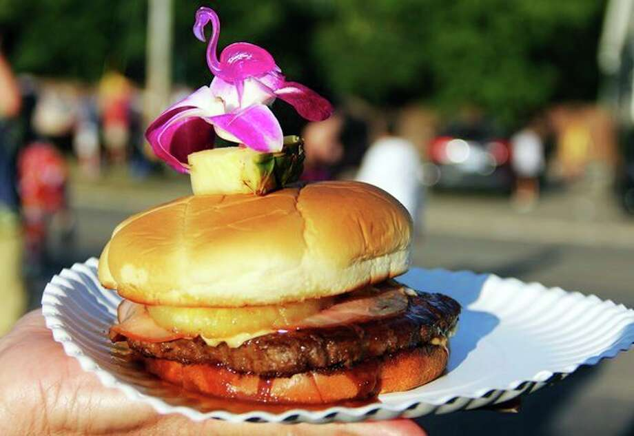 A Hawaiian Ono burger was one of 19 burgers judged at the Best Cheeseburger contest, held during the Cheeseburger in Caseville festival. (Andrew Mullin/Huron Daily Tribune)
