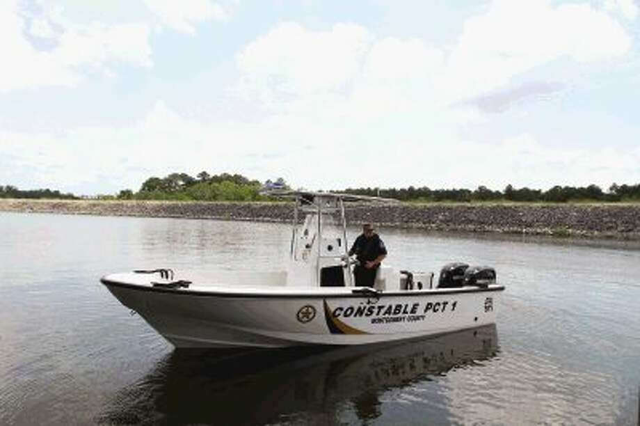 With the growth of boating on Lake Conroe, Montgomery County commissioners took steps to keep the waters safe by purchasing a new patrol boat for the Precinct 1 Marine Division. Photo: Staff Photo By Jason Fochtman / AP