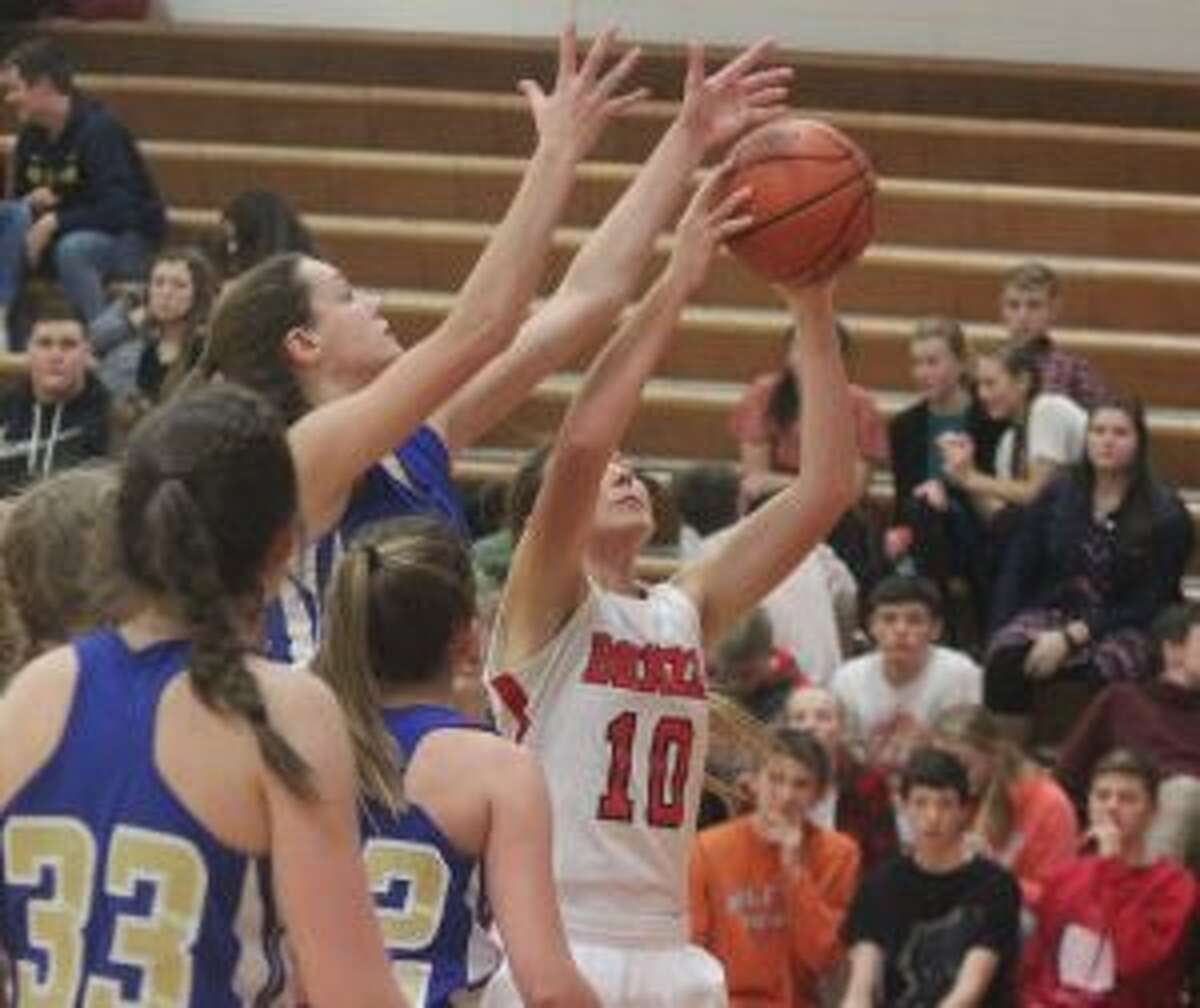 Benzie Central's Bella Huddleston grabs an offensive rebound during the Huskies' 48-27 victory over Onekama. (Photo/Robert Myers)
