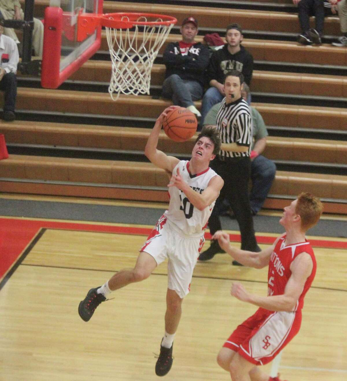 Ryan Kennedy gets past a defender for a transition layup to lead Benzie Central to victory over Suttons Bay. (Photo/Robert Myers)