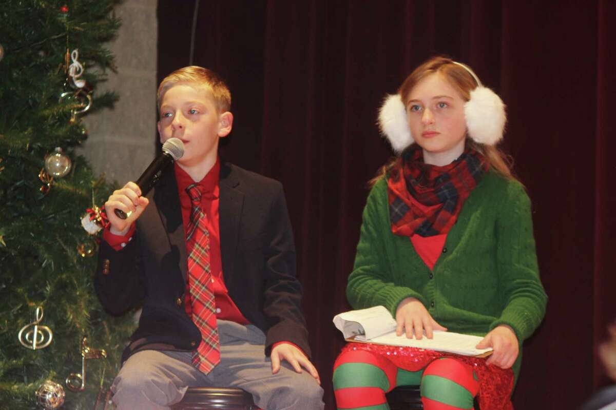 Carson Case and Candy Cane play the broadcasters of the Reindeer Games. (Photo/Robert Myers)
