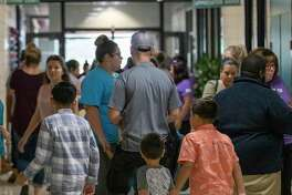A crowd of parents and students leave and enter during the first day of school Wednesday, August 14, 2019 at CC Hardy Elementary School in Willis.