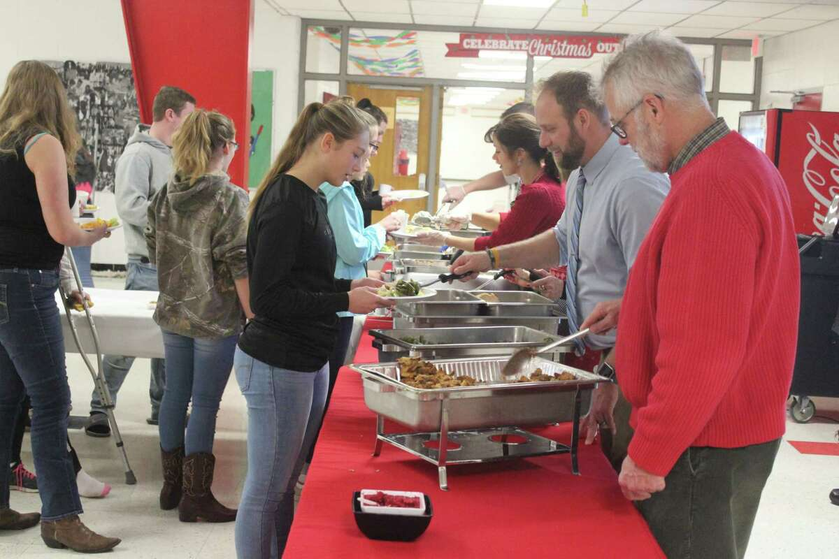 Staff members serve a free holiday lunch to Benzie Central students. (Photo/Robert Myers)